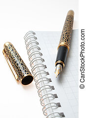 business organizer, notebook or planner with gold pen