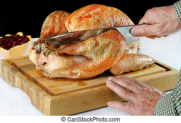 Roast Turkey on Cutting Board with Hands and Knife Carving....