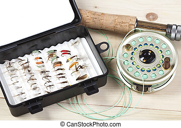 Fishing Tackle - Fly fishing rod and reel with a silver...