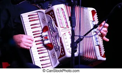 Playing Accordion - Playing an old fashioned accordion