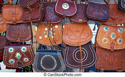 Moroccan leather goods bags in a row at market