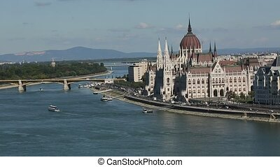 View of Hungarian Parliament Building on the bank of the...