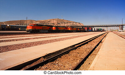 Speeding train passing through Barstow Junction, California