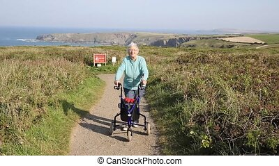 Active old lady with mobility aid - Active old lady...