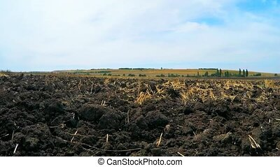Plowed Agricultural Soil At Rural Field Before Sowing -...