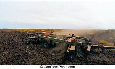 Rural Tractor Plowing Agricultural Field - CLOSE UP: Slow...