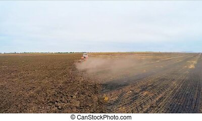 Rural Tractor Ploughing Agricultural Field In Russia - Rear...