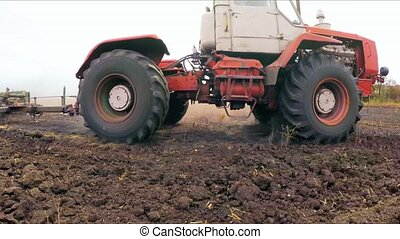 Tractor With Raised Trailer For Cultivation Driving In The Field In Ukraine