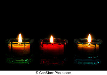 Three Lit Candles for a bottom border on black.