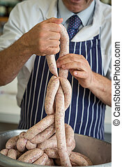 How to tie up sausages - Friendly butcher linking and...