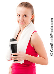 Young fit woman with towel