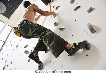 climbing - young and fit man exercise free mountain climbing...