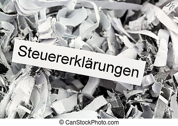 shredded paper tax returns - papierschnitzel tagged with tax...