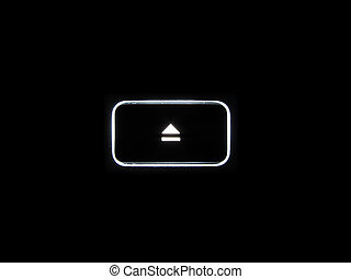 Eject button - A backlit Eject button isolated on a black...