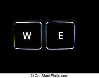WE - Backlit keyboard buttons showing WE isolated on a black...
