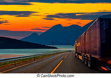 Truck on road - Truck traveling on the road at sunset.