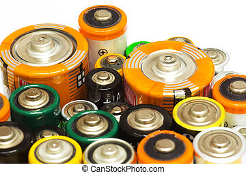 Batteries - Group of Old AA, AAA and C Batteries in Closeup...