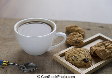 Cup of coffee with chocolate cookies