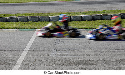 go kart - ga kart in race in the circuit