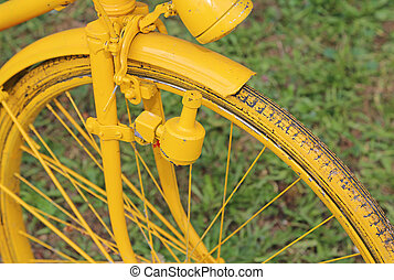 old bicycle with the bottle dynamo on the front wheel -...