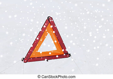 closeup of warning triangle on snow - transportation and...