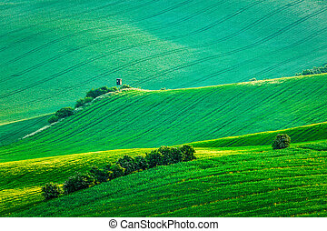 Moravian rolling landscape with hunting tower shack on...