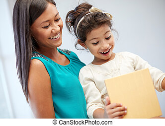 happy mother and child with gift box