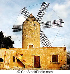 windmill - a view of a tipical old windmill in mallorca,...
