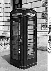 Traditional telephone booth in London, black and white...