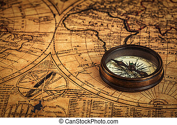 Old vintage compass on ancient map - Travel geography...