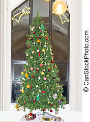 Christmas tree presents and decorations against a modern...