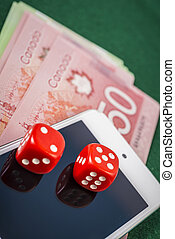Online gambling - Ipod, cash, dice on line gambling concept