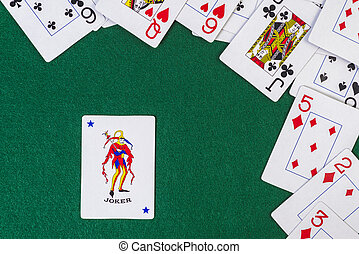 Scattered playing cards with the joker - Joker cards...