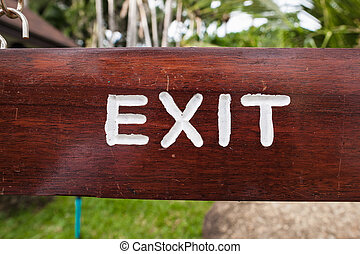 Exit sign at park. wooden sign on Koh Samui in Thailand