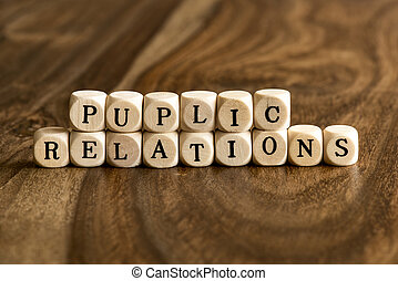 Word PUPLIC RELATIONS on wooden cubes - PUPLIC RELATIONS...