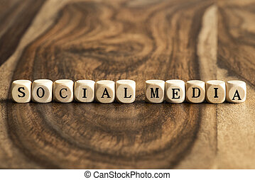 Word SOCIAL MEDIA on wooden cubes