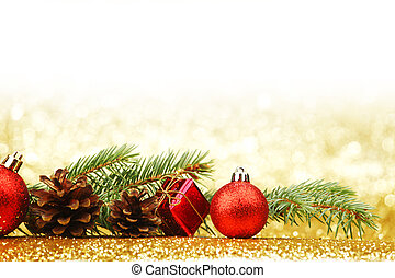 Christmas card with fir tree branch and decoration on golden...