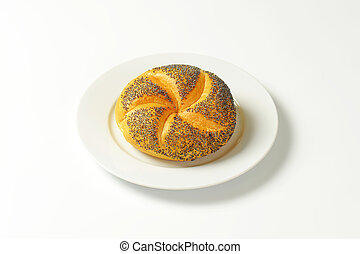 poppy seed bun - fresh poppy seed bun on white plate