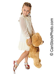 Girl with soft toy - Beautiful blonde girl of school age in...