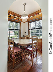 Eating area with wood floors