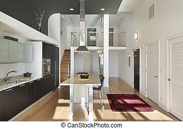 Contemporary kitchen in condominium with granite island