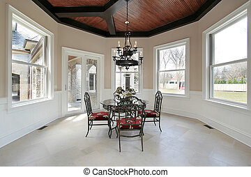 Eating area with circular ceiling and candle chandelier