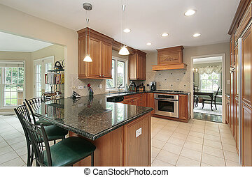 Kitchen with granite island - Kitchen in suburban home with...