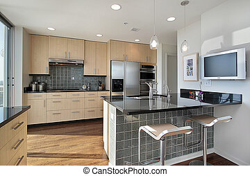 Kitchen with granite island - Kitchen in contemporary condo...