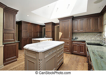 Kitchen with white marble island