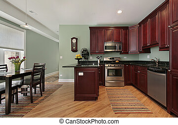 Kitchen with cherry wood cabinetry - Kitchen in condominium...