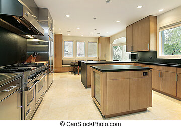 Kitchen with black counters