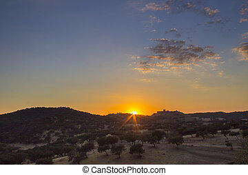 Sunset countryside landscape scenic view of medieval Noudar...