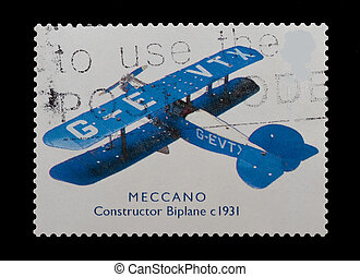 meccano biplane - british mail stamp featuring the Meccano...