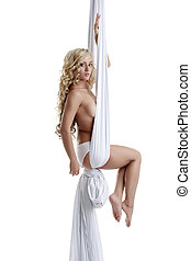 Aerial silk Hot brown-eyed woman dancing topless - Aerial...